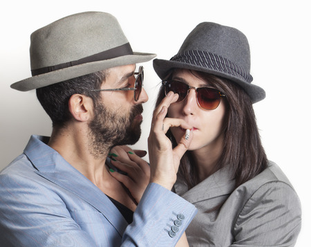 Beautiful gangster couple smoking