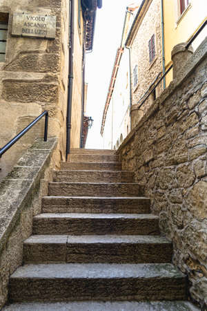 Old stairs, surrounded by Italian buildings. A place for sightseeing by tourists. europe
