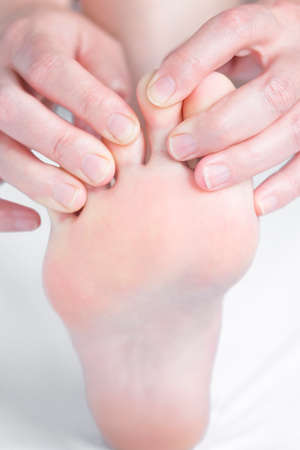 Foot pain, foot massage, physiotherapy