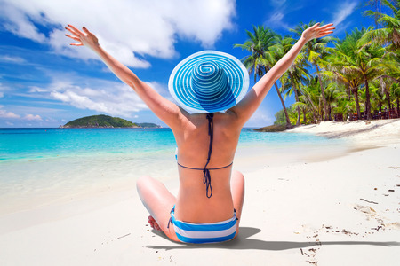 woman in bath: Woman in hat enjoying sun holidays on the tropical beach Stock Photo
