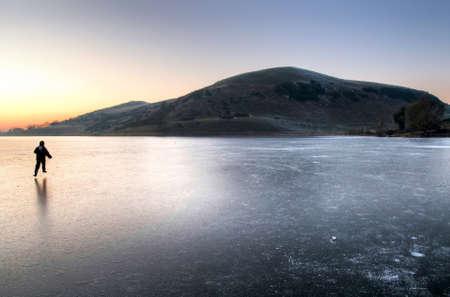 frozen lake: Sunset on frozen lake Stock Photo