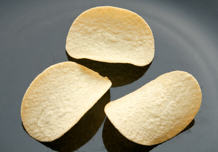 crisps: Potato crisps Stock Photo
