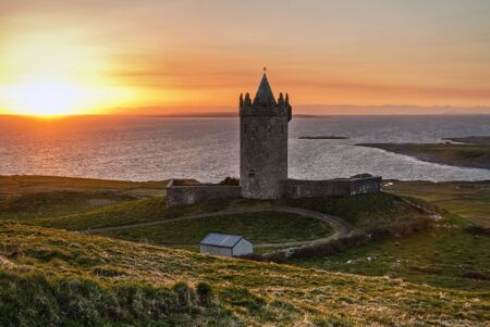 irish history: Doonagore castle at sunset