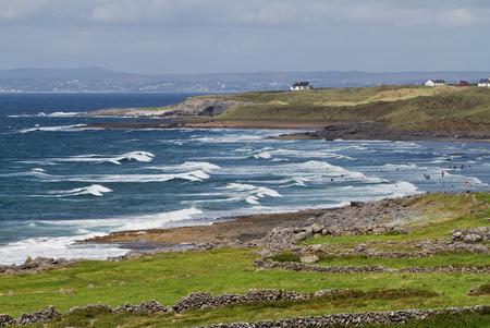 doolin: Surfing on Irish beach in Fanore Stock Photo