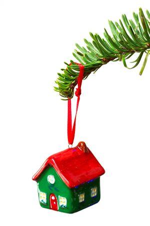 christmas house: House shape bauble hanging on Christmas tree