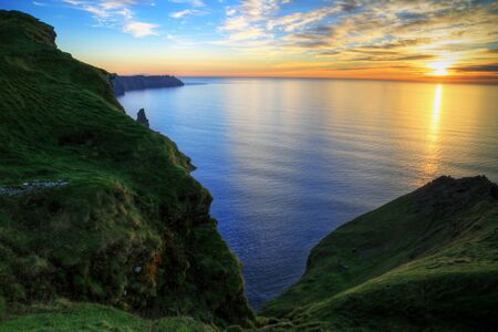 doolin: Cliffs of Moher at sunset in Ireland Stock Photo