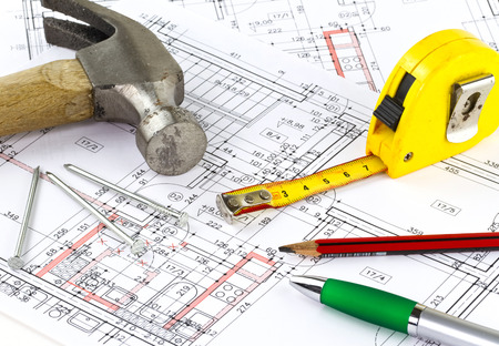 construction plans: Renovation plan of the apartment with hammer and nails Stock Photo