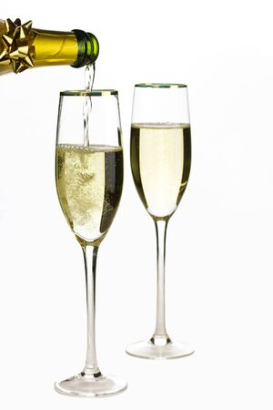 poured: Champagne being poured into glass