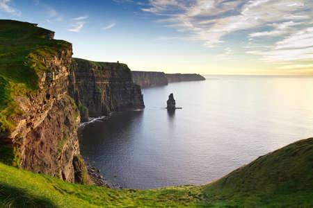 moher: Cliffs of Moher at sunset in Ireland Stock Photo