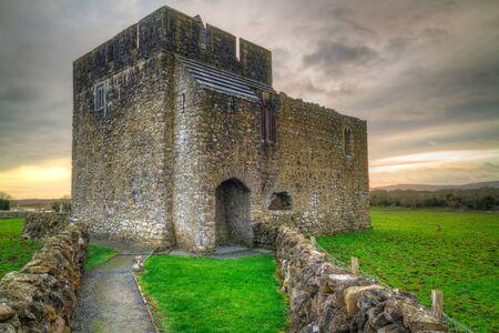 ancient ireland celtic cross: Stone architecture of Kilmacduagh monastery in Ireland Editorial