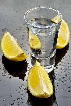 alcoholic beverage: Vodka shot with sliced lemon