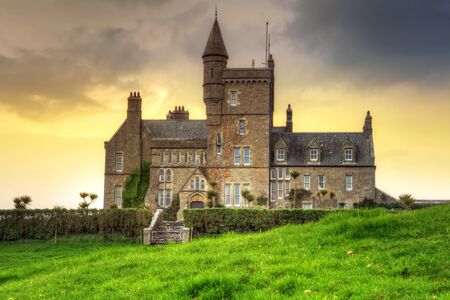 sligo: Classiebawn Castle on Mullaghmore Head at sunset in Co. Sligo, Ireland