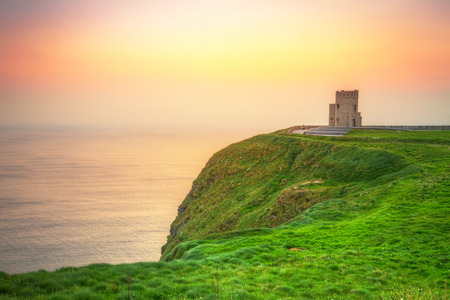 shore: Tower on the Cliffs of Moher at sunset, Ireland Stock Photo