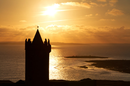 doolin: Silhouette of Doonagore Castle at sunset, Ireland