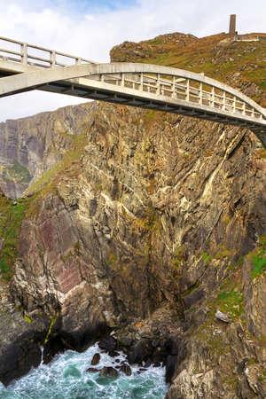 co cork: Bridge to at Mizen Head and Lighthouse, Co. Cork, Ireland Stock Photo