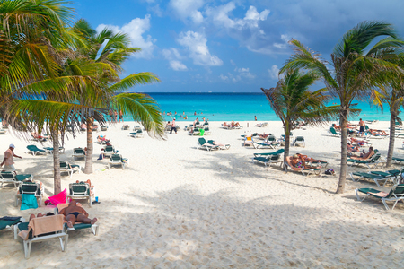 Tourists on the beach of Playacar at Caribbean Sea in Mexico
