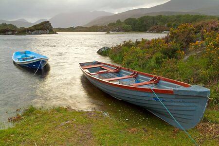 co  kerry: Boats on Killarney lake in Co. Kerry, Ireland