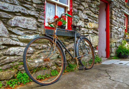 Old rusty bike at Irish cottage house Stock Photo