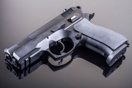 9mm ammo: 9mm hand gun on glass table
