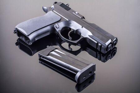 gunfire: 9mm hand gun on glass table