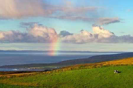 doolin: Irish landscape with rainbow over the ocean