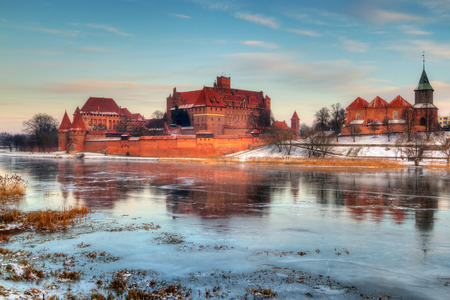 teutonic: Teutonic castle in Malbork with reflection in frozen Nogat river, Poland