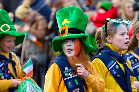 saint: Children in Irish hat participate in a parade for St. Patricks Day