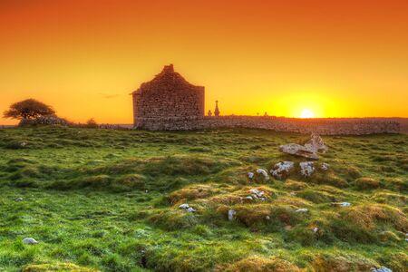 burren: Ruins of old Irish chapel in Burren at sunrise