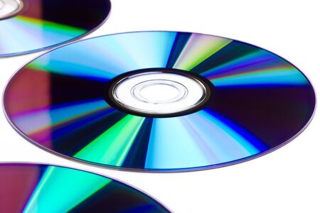 recordable: Surface of compact discs over white background