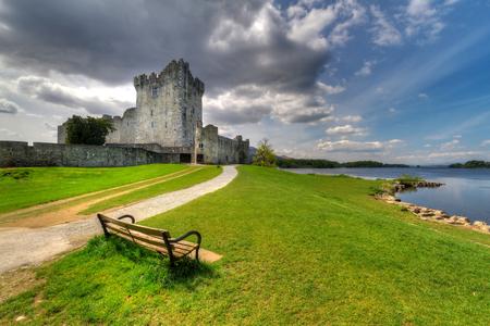 co  kerry: Ross Castle with empty bench near Killarney, Co. Kerry, Ireland