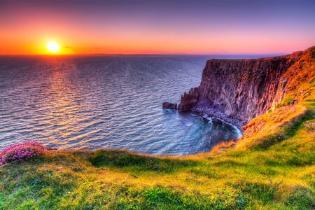 moher: Cliffs of Moher at sunset in Co. Clare, Ireland Stock Photo