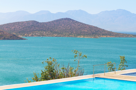 blue waters: Blue waters of Mirabello Bay in Greece Stock Photo