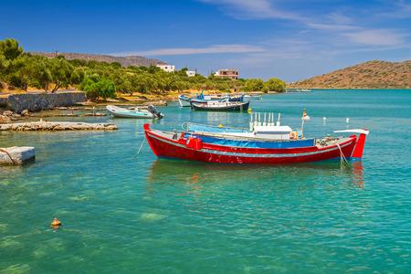 ocean fishing: Fishing boats on the blue lagoon of Crete, Greece