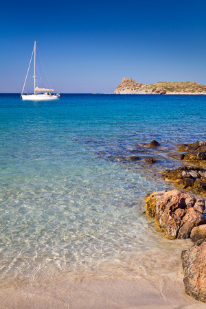 White yacht on the idyllic beach lagoon of Crete, Greece