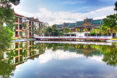 koh kho khao: Oriental architecture reflected in the pond at sunrise, Thailand