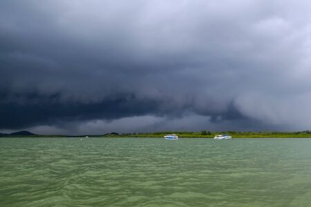 koh kho khao: Dark stormy clouds approaching the river Stock Photo