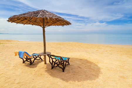 koh kho khao: Tropical beach scenery with parasol and deckchairs in Thailand Stock Photo