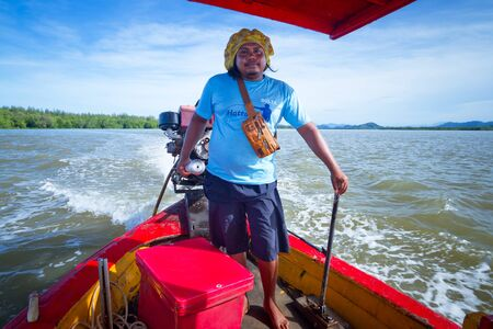 koh kho khao: Man navigating his boat to transport tourist from Bang Muang to Koh Kho Khao island, Thailand