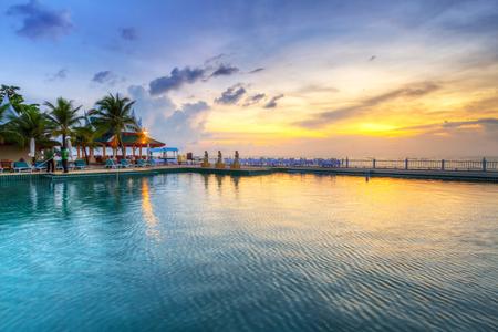 koh kho khao: Pool area of Andaman Princess Resort & Spa at sunset