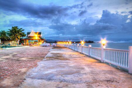 koh kho khao: Sunset at swimming pool of Andaman Princess Resort & Spa Editorial