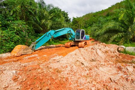 Digger in the tropical jungle of Thailand