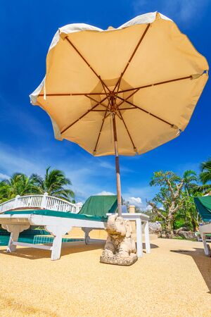 koh kho khao: Tropical resort scenery with parasol and deckchairs in Thailand