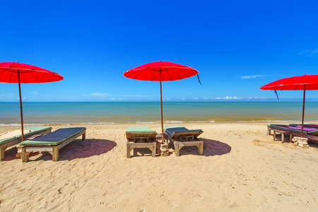 koh kho khao: Red parasols with deckchairs on tropical beach in Thailand
