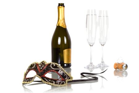 silver flute: Bottle of champagne with two flutes and party mask Stock Photo