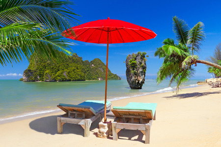 koh kho khao: Tropical beach scenery with red parasol and deckchairs in Thailand Stock Photo