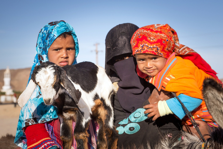 hurghada: Arabic family with goat and donkey on the local bus station near Hurghada Editorial
