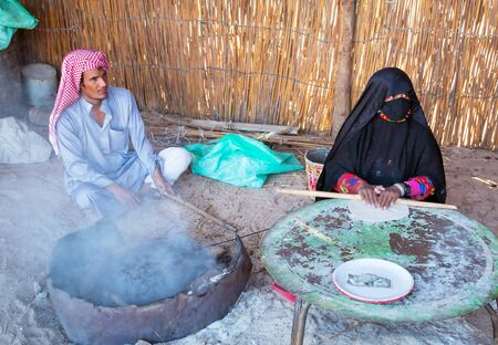 bedouin: People baking bread in the bedouin village on the desert near Hurghada