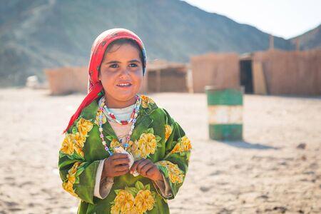 Bedouin girl in the village on the desert near Hurghada