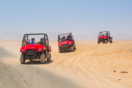 People on a quad trip on the desert near Hurghada Stock Photo