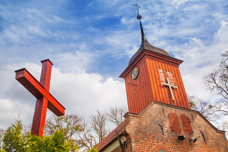 church architecture: Small cottage church in the summer scenery, Poland Stock Photo